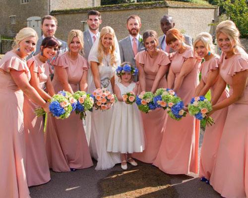 Bride Wears Modern Gown For Her Elegant Summer Wedding